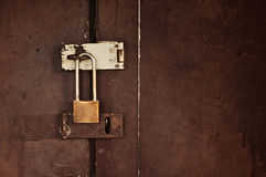 Lock on a wooden door Royalty Free Stock Image