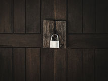 Lock on wooden door Royalty Free Stock Photos