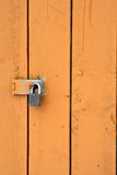 Locked. Old door with padlock royalty free stock images