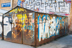 Locked abandoned garage with grungy graffiti Royalty Free Stock Images