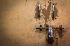 Locked antique doors in Asia. Royalty Free Stock Photo