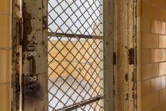 Locked barred door inside Trans-Allegheny Lunatic Asylum Royalty Free Stock Photos