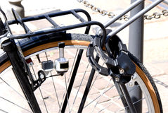 Locked bicycle. Bicycle locked to prevent theft Royalty Free Stock Photos