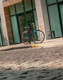 Locked Bicycle. Lock bike on curb in NYC Royalty Free Stock Photos