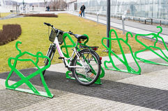 Locked Bicycle. POZNAN, POLAND - FEBRUARY 16, 2013: Bicyle locked on a rack by a shopping mall Stock Photos