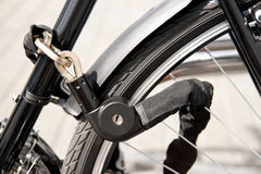 Locked bike Stock Images