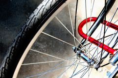 Locked Bike Wheel Stock Photography