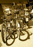 Locked bikes in a street. Sepia tone Stock Photos