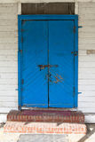 Locked blue door Stock Image