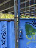 Locked blue metal gates Stock Photo