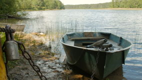 Locked boat by the lake stock footage