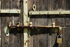 Locked and Bolted. Old wooden door locked and bolted Royalty Free Stock Image