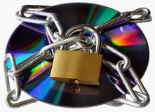 Locked cd rom. Information security and data protection. a cd rom protected, locked in Stock Images