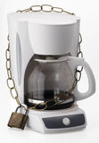 Locked coffeemaker. Coffe maker locked chain decaf bad habit Royalty Free Stock Images