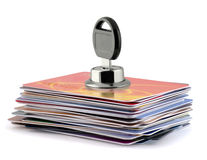 Locked credit cards. Stack of credit cards with key inserting in lock hole Royalty Free Stock Photo