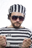 Locked, Desperate, portrait of a man prisoner in prison garb, ov Royalty Free Stock Photos