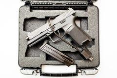 Locked disarmed handgun in case white background. Locked disarmed secured handgun in case white background Stock Image