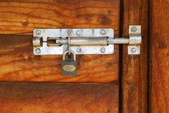 Locked door. Padlock on a wooden door stock photo