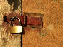 Locked door. A door locked with golden padlock Stock Image