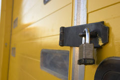 Locked door. A padlock on warehouse door Stock Photography