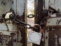Locked door Stock Images
