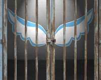 Locked door with blue and white wings drawing on wall. Locked door with blue and white wings drawing on concrete wall Royalty Free Stock Photos