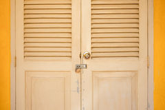 Locked door in classic building Stock Photo