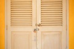 Locked door in classic building Stock Photo