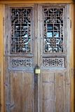 Locked door. The close-up of locked Chinese classcal wooden door with carved designs Royalty Free Stock Photo