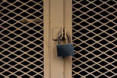 Locked door. Closed padlock on an old metal door Royalty Free Stock Images