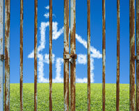 Locked door with cloud house in beautiful landscape green meadow. Blue sky background Royalty Free Stock Photography