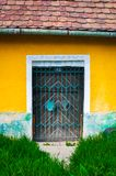 Locked door and colorful yellow wall Royalty Free Stock Image