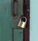 Locked door. A key locked the green door Stock Photo