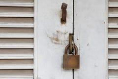 Locked door with key Stock Image