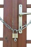 Locked door with key Stock Photography