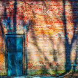 Locked door in an old brick wall Royalty Free Stock Photography