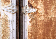 Locked door. From an old rusty container stock photography