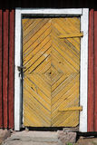 Locked door of old village house. Rural view: deteriorated door of old village house. Taken in Lappeenranta, Finland Stock Photo