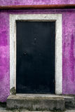 Locked door on the purple wall Royalty Free Stock Photography