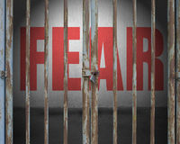 Locked door with red word fear on concrete wall. In empty space Stock Photos