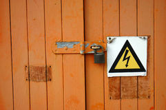 Locked door with warning sign Stock Image