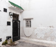 Locked door and white walls. Old Medina, historical part of Tang Stock Image