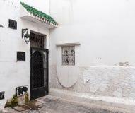 Locked door and white walls. Old Medina, historical part of Tang Stock Image