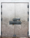 Locked doors. Large metal locked exterior doors Stock Photo