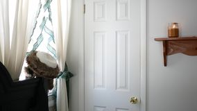 A locked down shot of a closed door closet storage room in white bedroom stock footage