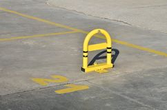 Empty parking lot. Locked empty parking lot outdoors with a number Stock Images