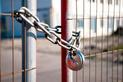 Locked fence. A locked fence in front of a building site Royalty Free Stock Photography