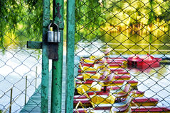 Locked fence to river. With catamarans Royalty Free Stock Photos