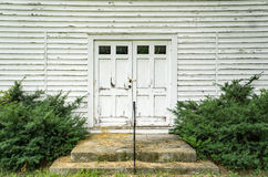Locked Front Door of a Church Door. A locked front door of an old abandoned white church located in the Blue Ridge Mountains of Virginia, USA Stock Image