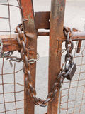 Locked gate. Close up of a locked gate showing chain and padlock Royalty Free Stock Image